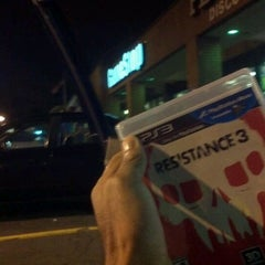 Photo taken at GameStop by Wolf H. on 9/6/2011