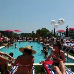 Photo taken at Penthouse Pool Club by Andrew W. on 7/4/2012