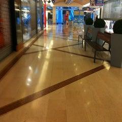 Photo taken at Auchan by Roberta R. on 3/27/2012