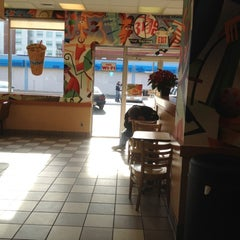 Photo taken at Dunkin Donuts by Erin V. on 3/10/2012