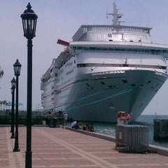 Photo taken at Mallory Square by Mitch D. on 4/1/2012