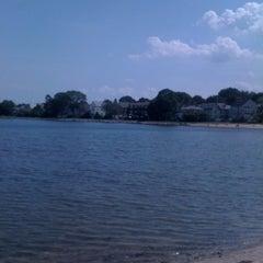 Photo taken at Collins Cove Beach by Carolina B. on 8/18/2011