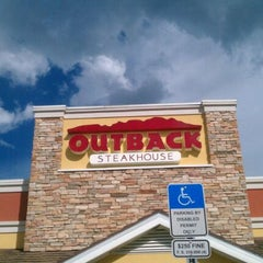 Photo taken at Outback Steakhouse by Maria O. on 9/27/2011