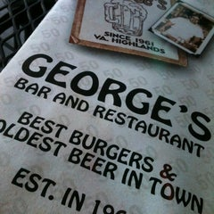 Photo taken at George's Bar & Restaurant by Jennifer K. on 10/15/2011