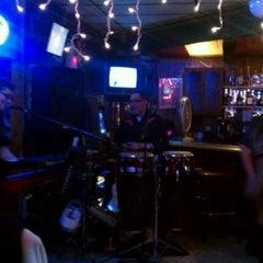 Photo taken at Gigi's Cocktail Lounge by Susan H. on 12/18/2011