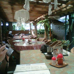 Photo taken at Tizi's Restaurant & Bar by Indar Y. on 6/27/2012