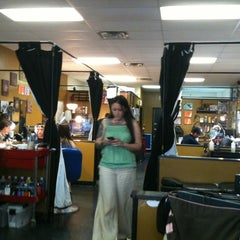 Photo taken at Dragon's Den Tattoo by Cee K. on 5/18/2012