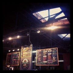 Photo taken at Millcreek Coffee Roasters by Jonny B. on 1/26/2012