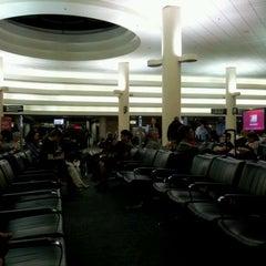 Photo taken at Gate 57 by Jerome J. on 4/27/2012