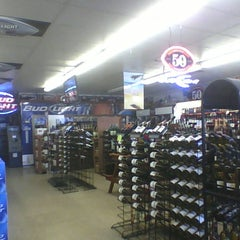 Photo taken at Mile High Liquor by matthew j. on 4/1/2012