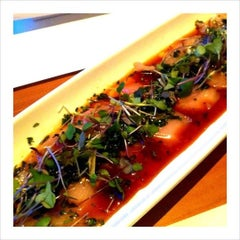 Photo taken at Sushi Yuzu by Christine M. on 2/7/2012