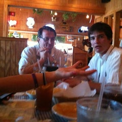 Photo taken at Buffalo Grill by Evan T. on 6/19/2011