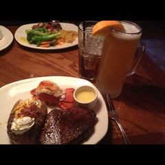 Photo taken at Outback Steakhouse by Taurian B. on 4/24/2012