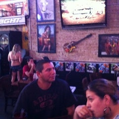 Photo taken at Bikinis Sports Bar & Grill by Tito G. on 10/14/2011