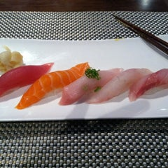 Photo taken at Xaga Sushi & Asian Fusion by Lisa S. on 12/31/2011