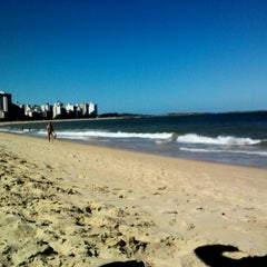 Photo taken at Praia da Costa by Thamyris C. on 3/1/2012