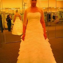 Photo taken at David's Bridal by Zimbabwe H. on 4/19/2012