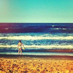 Photo taken at Praia Brava by Guilherme M. on 4/6/2012