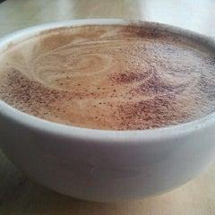 Photo taken at Guerilla Cafe by Kimfectious O. on 2/10/2012