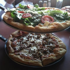 Photo taken at Mellow Mushroom by Bre B. on 3/5/2012