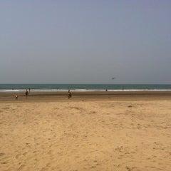 Photo taken at Morjim Beach by Ann K. on 3/17/2012