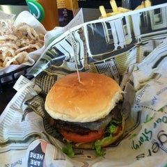 Photo taken at Wahlburgers by Kate Y. on 4/28/2012