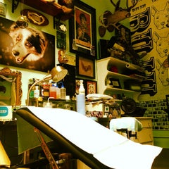 Photo taken at Buju Tattoo by Leslie G. on 7/22/2012