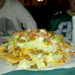 Photo taken at El Roco Bar & Grill by Lee S. on 5/20/2011
