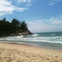 Photo taken at Praia da Ferrugem by Eva U. on 1/4/2011