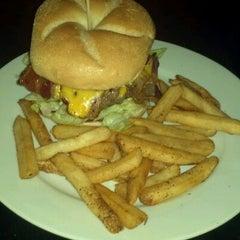 Photo taken at Grindz Burgers & Brew by Brad M. on 8/25/2011