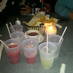 Photo taken at Ozona Bar & Grill by Jose T. on 1/10/2012