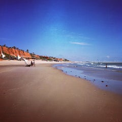 Photo taken at Praia de Canoa Quebrada by Diego M. on 5/1/2012