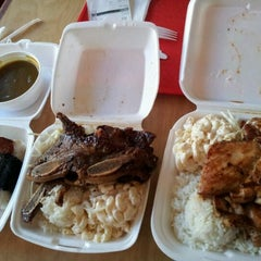 Photo taken at Aloha Eats by Jeanna L. on 3/18/2012
