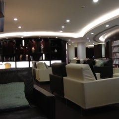 Photo taken at Etihad Airways Lounge by PEI Consulting on 7/11/2012