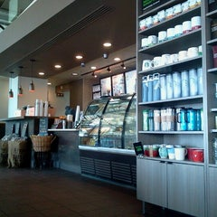 Photo taken at Starbucks by Lourdes B. on 8/12/2012