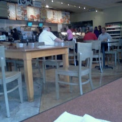 Photo taken at Einstein Bros Bagels by A S. on 11/28/2011