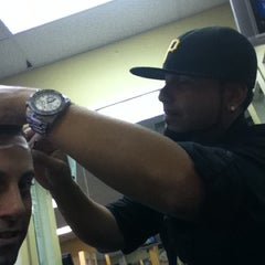Photo taken at Rabelo's Barber Shop by DJ SHORTE on 7/18/2011