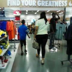Photo taken at Nike Factory Store by Nikkip L. on 8/11/2012