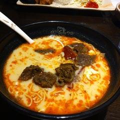 Photo taken at Ajisen Ramen by Stephanie Y. on 7/22/2012