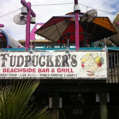 Photo taken at Fudpuckers Beachside Bar & Grill by Stephen R. on 10/9/2011