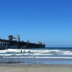 Photo taken at Oceanside Pier by Diana M. on 6/26/2012