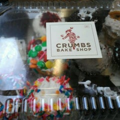 Photo taken at Crumbs Bake Shop by Johanna R. on 9/24/2011