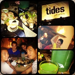 Photo taken at Tides Grill & Bistro by Rian C. on 8/18/2012