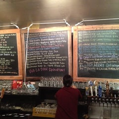 Photo taken at Beer Revolution by Melanie N. on 2/19/2012