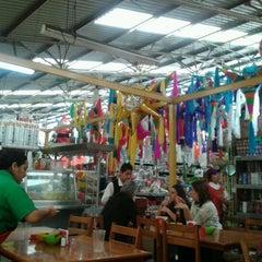 Photo taken at Mercado 24 de Agosto by KARY B. on 12/20/2011