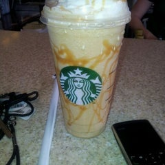 Photo taken at Starbucks by Natasha W. on 3/15/2012