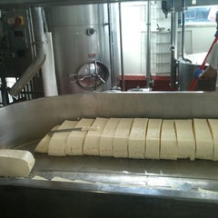 Photo taken at Beecher's Handmade Cheese by Haley B. on 4/4/2012