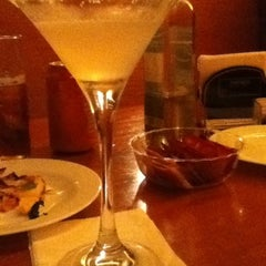 Photo taken at Faenza Pizza & Grill by Juliana F. on 4/7/2012