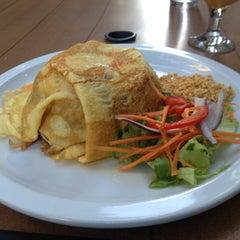 Photo taken at Pi-Tom's Thai Cuisine by Michael K. on 6/14/2012
