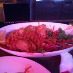 Photo taken at Lotus Bar & Grill by Nikki C. on 9/21/2011
